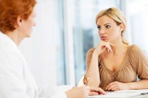 Worried woman visiting a psychologist.  [url=http://www.istockphoto.com/search/lightbox/9786662][img]http://dl.dropbox.com/u/40117171/medicine.jpg[/img][/url]