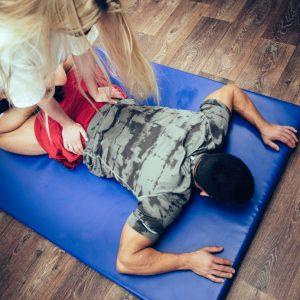 therapist massaging  patientslower back