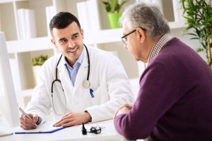Doctor explaining prescription to senior patient, healthcare concept
