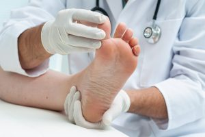 Doctor examines the foot
