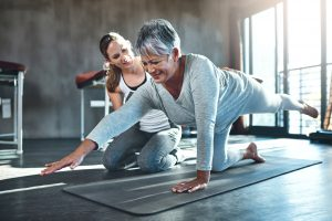 senior woman working out with her physiotherapist